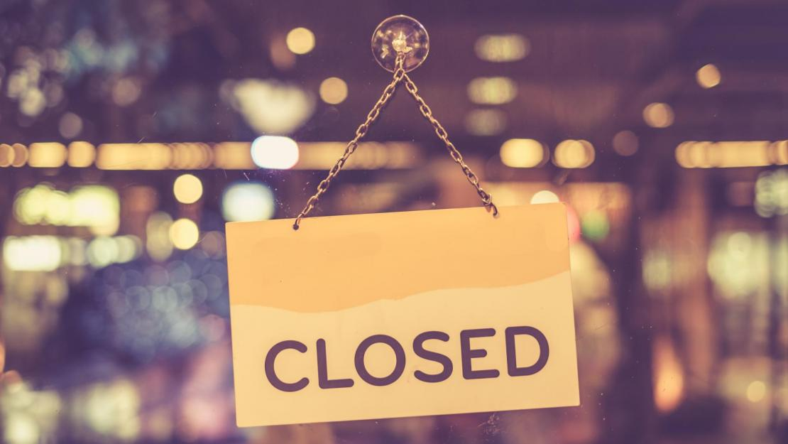 Closed sign hanging in shop window